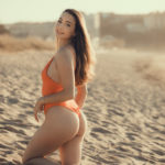 Rodillas en la arena